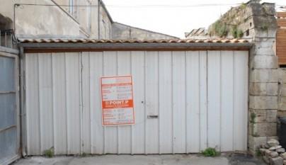 Garaje Pasaje Buhan puertas antes
