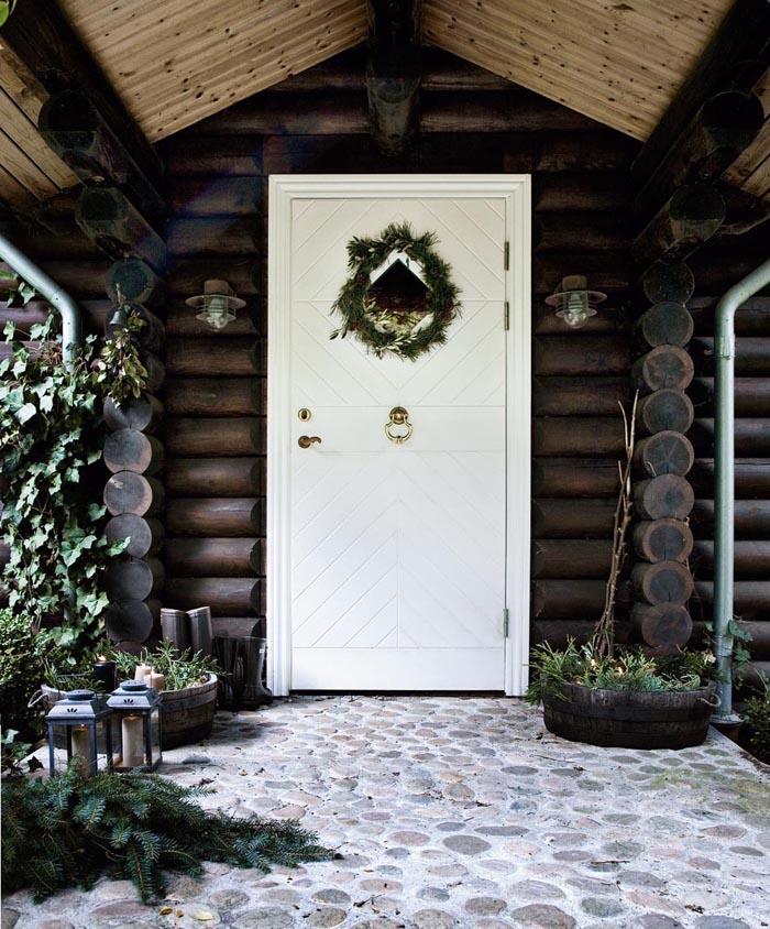 decorar-la-casa-en-navidad-entrada-rustica-700x844