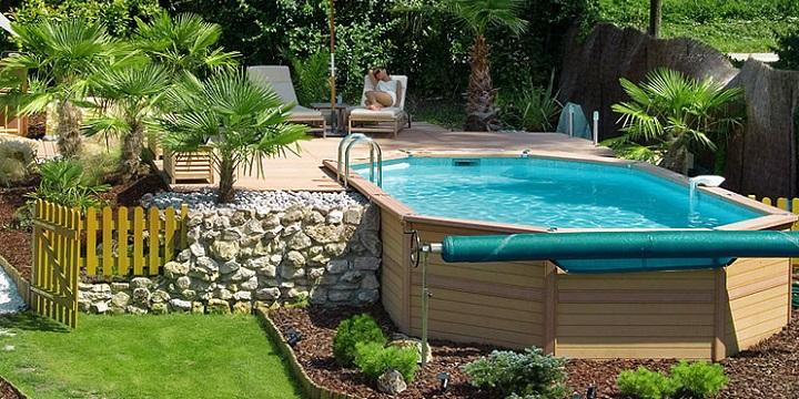 Piscinas de madera baratas for Casas de madera con piscina