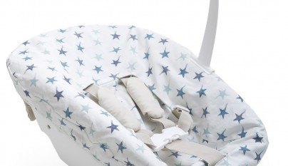 Tripp Trapp® Newborn Set with Aqua Reversed Cover.