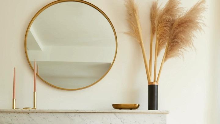espejo-redondo-con-marco-dorado